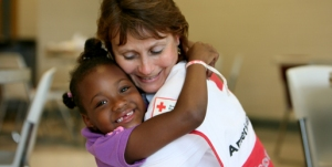 American Red Cross volunteer Pam Rogers with Victoria Key, 5, at the Red Cross Shelter at Belk Activity Center in Tuscaloosa, Alabama.